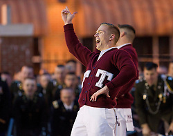 A Texas Aggies band member leads chants during a pep rally in downtown Memphis.