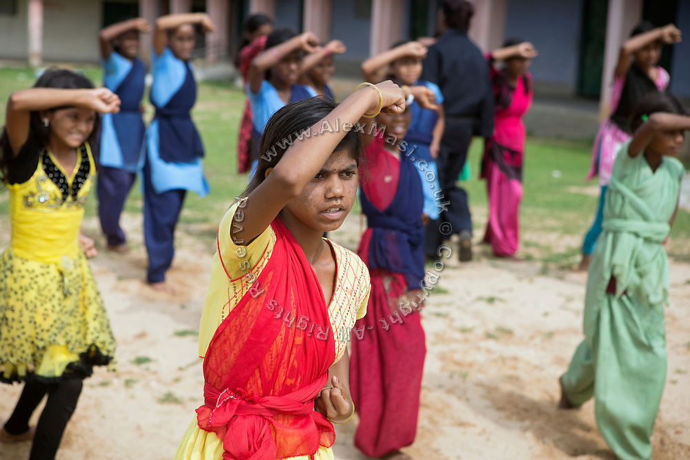 Tabasum Khatun, 14, is practising a Karate defensive move during a class in Algunda village, pop. 1000, Giridih District, rural Jharkhand, India.
