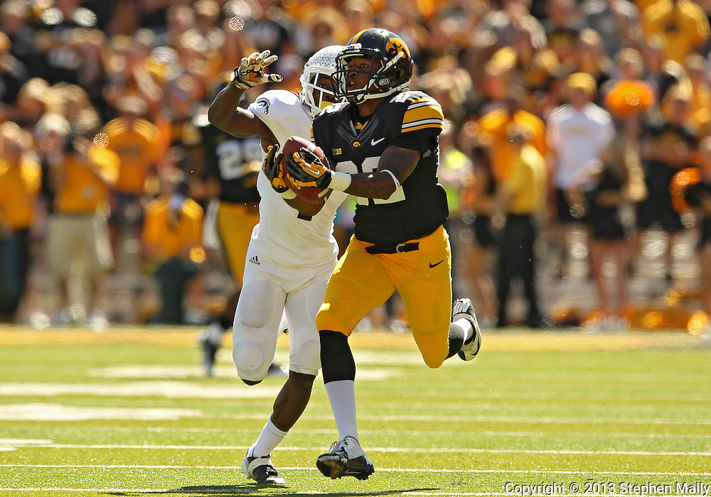 September 21 2013: Iowa Hawkeyes wide receiver Damond Powell (22) pulls in a 54 yard pass reception as Western Michigan Broncos cornerback Ronald Zamort (7) defends during the fourth quarter of the NCAA football game between the Western Michigan Broncos and the Iowa Hawkeyes at Kinnick Stadium in Iowa City, Iowa on September 21, 2013. Iowa defeated Western Michigan 59-3.
