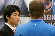 Ohio University student ZioJhe Yang speaks with a representative of Columbia Gas Transmission and Storage during the career fair in the Baker University Center on Wednesday, October 3, 2007..photo by Kevin Riddell