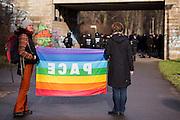 Magdeburg | 18 Jan 2014<br /> <br /> ACHTUNG BESONDERE HONORARKONDITIONEN!<br /> <br /> Am Samstag (19.01.2014) marschierten etwa 1000 Neonazis bei einem &quot;Gedenkmarsch&quot; durch Magdeburg, um der Bombardierungen der Stadt im 2. Weltkrieg zu &quot;gedenken&quot;.<br /> Hier: Zwei Anti-Nazi-Demonstrantinnen mit einer Regenbogenfahne mit der Aufschrift &quot;Pace&quot; an der Haltestelle Magdeburg-Herrenkrug, im Hintergrund die dort wartenden Neonazis.<br /> <br /> &copy;peter-juelich.com<br /> <br /> [No Model Release | No Property Release]
