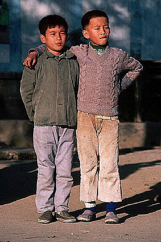 1983, Foshan, Guangdong Province, China --- Boy With Arm Around Shoulder of Another --- © Owen Franken