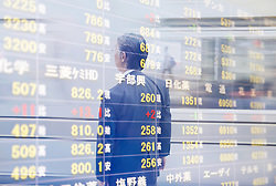 November 22, 2015 - Reflection in glass of man in front of stock exchange information board. (Credit Image: © Mint Images via ZUMA Wire)