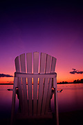 Muskoka chair on shore of Lake of the Woods<br />