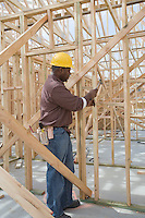 Construction worker hammering framework