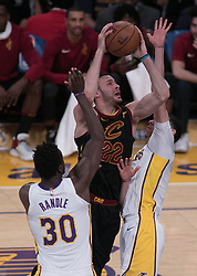 March 11, 2018 - Los Angeles, California, U.S - Larry Nance Jr. #22 of the Cleveland Cavaliers drives between Lonzo Ball #2 and Julius Randle #30 of the Los Angeles Lakers during their NBA game on Sunday March 11, 2018 at the Staples Center in Los Angeles, California. Lakers defeat Cavaliers, 127-113. (Credit Image: © Prensa Internacional via ZUMA Wire)