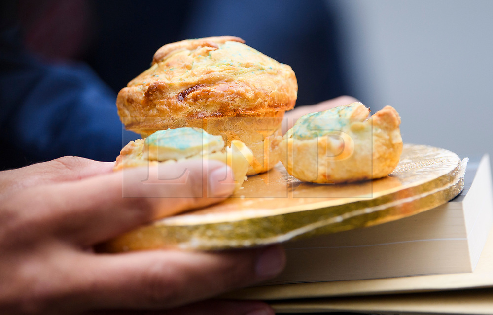 © Licensed to London News Pictures. 12/06/2018. London, UK. Pork pies which were presented to Leave.EU founder ARRON BANKS and Leave.EU campaigner ANDY WIGMORE by a remain supporter, as they arrived at Portcullis House in London where they are due to give evidence to a Commons Digital, Culture, Media and Sport Committee about fake news. The pair have been accused of collusion with Russian officials around the time of the Brexit referendum. Photo credit: Ben Cawthra/LNP