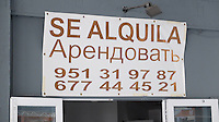 Signage in Russian on the Costa del Sol, Spain, shows its popularity with Russian ex-pats & tourists, letting sign previously in Spanish & English now in Spanish & Russian, Puerto Banus, February, 2015, 201502060390<br /> <br /> Copyright Image from Victor Patterson, 54 Dorchester Park, Belfast, UK, BT9 6RJ<br /> <br /> t: +44 28 9066 1296<br /> m: +44 7802 353836<br /> vm +44 20 8816 7153<br /> <br /> e1: victorpatterson@me.com<br /> e2: victorpatterson@gmail.com<br /> <br /> www.victorpatterson.com<br /> <br /> IMPORTANT: Please see my Terms and Conditions of Use at www.victorpatterson.com