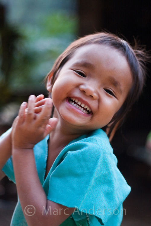 Young girl laughing,  Mae Sam Laep, Mae Hong Son Province, Thailand