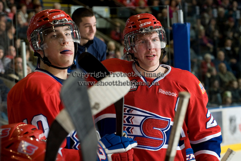 KELOWNA, CANADA, JANUARY 4: Blake Gal #10 and Darren Kramer #22 of the Spokane Chiefs stand on the bench as the Spokane Chiefs visit the Kelowna Rockets on January 4, 2012 at Prospera Place in Kelowna, British Columbia, Canada (Photo by Marissa Baecker/Getty Images) *** Local Caption ***