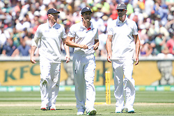 © Licensed to London News Pictures. 29/12/2013. Losing captain Alastair Cook walks off the field along side Kevin Pietersen (right) and Ben Stokes (left) during Day 4 of the Ashes Boxing Day Test Match between Australia Vs England at the MCG on 29 December, 2013 in Melbourne, Australia. Photo credit : Asanka Brendon Ratnayake/LNP