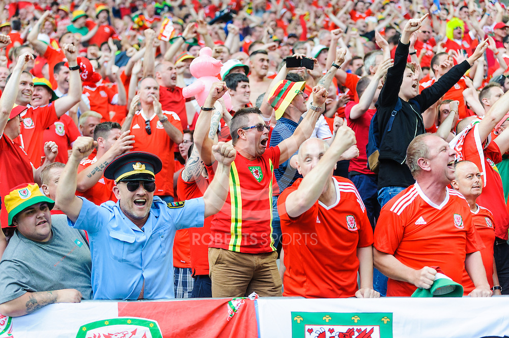Wales fans celebrate their team's 2nd goal. Action from the WALES v SLOVAKIA UEFA EURO 2016 game at Stade Matmut Atlantique in Bordeaux, 11 June 2016. (c) Paul J Roberts / Sportpix.org.uk