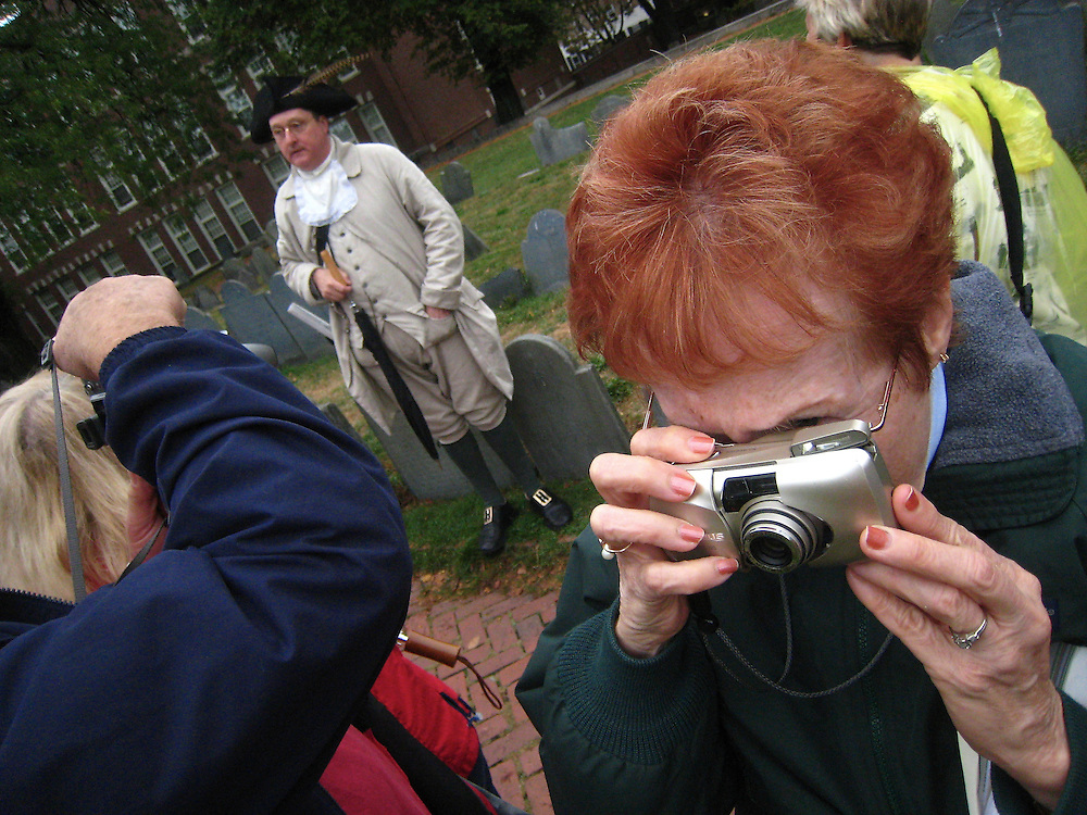 Redheaded tourist on Copps hill in boston with minuteman