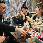 Nai Nai, a 23-year-old live-streamer in Shanghai, China, plays boardgames with her male fans. 