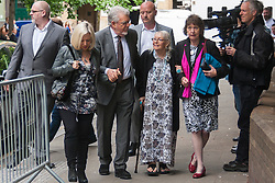 London, May 21st 2014. Entertainer Rolf Harris arrives with his daughter Bindi, left, his wife Alwen and his niece  Jenny, right, at Southwark Crown Court where his trial on 12 counts of indecent assault against girls aged between 7 and 19 continues.