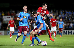 Lee Tomlin of Bristol City tries to go past Murray Wallace of Scunthorpe United - Mandatory by-line: Robbie Stephenson/JMP - 23/08/2016 - FOOTBALL - Glanford Park - Scunthorpe, England - Scunthorpe United v Bristol City - EFL Cup second round