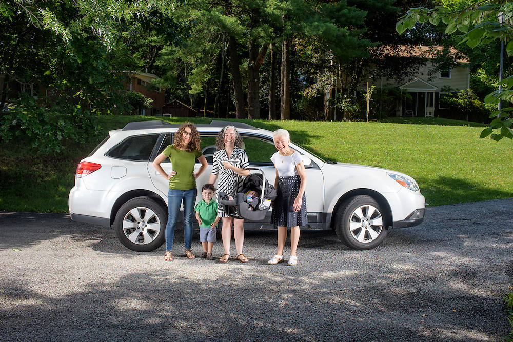Pikesville, Maryland - June 25, 2015:  The Car Seat Ladies (L-R) Emily Levine, 34, from Manhattan, Deborah Baer, 67, from Pikesville, Maryland, and her daughter Alisa Baer, 35, also from Manhattan, hold Alisa's 7 week-old niece Leora Aghion in a Nuna Pipa infant car seat, ($300) at her sister's house in Pikesville, Maryland Thursday June 25th, 2015. Alisa's nephew Eitan Aghion, 2, joins the Car Seat Ladies.<br />