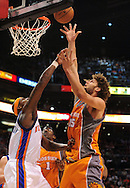 Mar. 26 2010; Phoenix, AZ, USA; Phoenix Suns center Robin Lopez (15) puts up a shot against New York Knicks forward Al Harrington (7) in the second half at the US Airways Center.  The Suns defeated the Knicks 132-96.  Mandatory Credit: Jennifer Stewart-US PRESSWIRE.