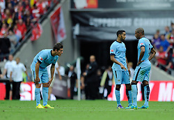 Manchester City players cut dejected figures as they lose to Arsenal in the FA Community Shield - Photo mandatory by-line: Dougie Allward/JMP - Mobile: 07966 386802 10/08/2014 - SPORT - FOOTBALL - London - Wembley Stadium - Arsenal v Manchester City - FA Community Shield