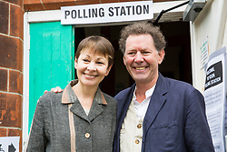 © Licensed to London News Pictures. 08/06/2017. Brighton, UK. MP and joint leader of the Green party Caroline Lucas with her husband Richard at Florence Rd Baptist Church Hall in Brighton to vote in the General Election, today June 8th 2017. Photo credit: Hugo Michiels/LNP