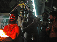 """India, Gokarna, 2006. Reaching the end of a five mile walk, Keralan Hindu dancers will carry on singing and dancing through the night in a yearly """"puja"""" ceremony."""