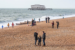 © Licensed to London News Pictures. 10/11/2016. Brighton, UK. Members of the public relax and enjoy time on the beach in Brighton and Hove. Photo credit: Hugo Michiels/LNP