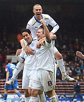 Football - Premier League - Fulham vs. Wigan Athletic<br /> Kenny Miller - Cardiff celebrates with goalscorer,Peter Whittingham (left) and Liam Lawrence (right)