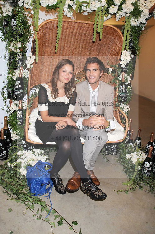 OSCAR HUMPHRIES and SARA PHILIPPIDIS at the Quintessentailly Summer Party at the Phillips de Pury Gallery, 9 Howick Place, London on 9th July 2008.<br /><br />NON EXCLUSIVE - WORLD RIGHTS