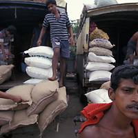 Sri Lanka, Colombo, Men work carrying bag and goods at Petah Market