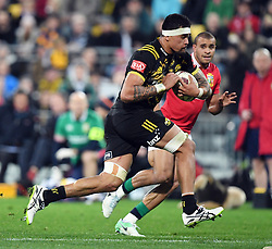 """Vaea Fifita of the Hurricanes runs pass Jonathan Joseph of the Lions in the International rugby match between the the Super Rugby Hurricanes and British and Irish Lions at Westpac Stadium, Wellington, New Zealand, Tuesday, June 27, 2017. Credit:SNPA / Ross Setford  **NO ARCHIVING"""""""