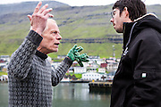 """Kristoffer Ragnarson, a local shipworker on the docks at Klaksvik harbor where 236 pilot whales were previously slaughtered, confronts Peter Hammarstedt of Sea Shepherd.  Ragnarson questions SS's actions in the Faroes, and Peter, in his natural stature and response-remains calm, and responds with """"You are a rich country now.  You do not need to eat whale meat to survive.""""<br /> <br /> Ragnarson retorts:  """" I will never stop killing whales. I love meat,"""" he says, and walks away. <br /> <br /> The Faroese do not understand how Sea Shepherd feels they have the right to be in the Faroes.  """"It is our country, what right do you have to come here and tell us what to hunt and what to eat?""""<br /> <br /> Klaksvik, Streymoy.  Faroe Islands."""
