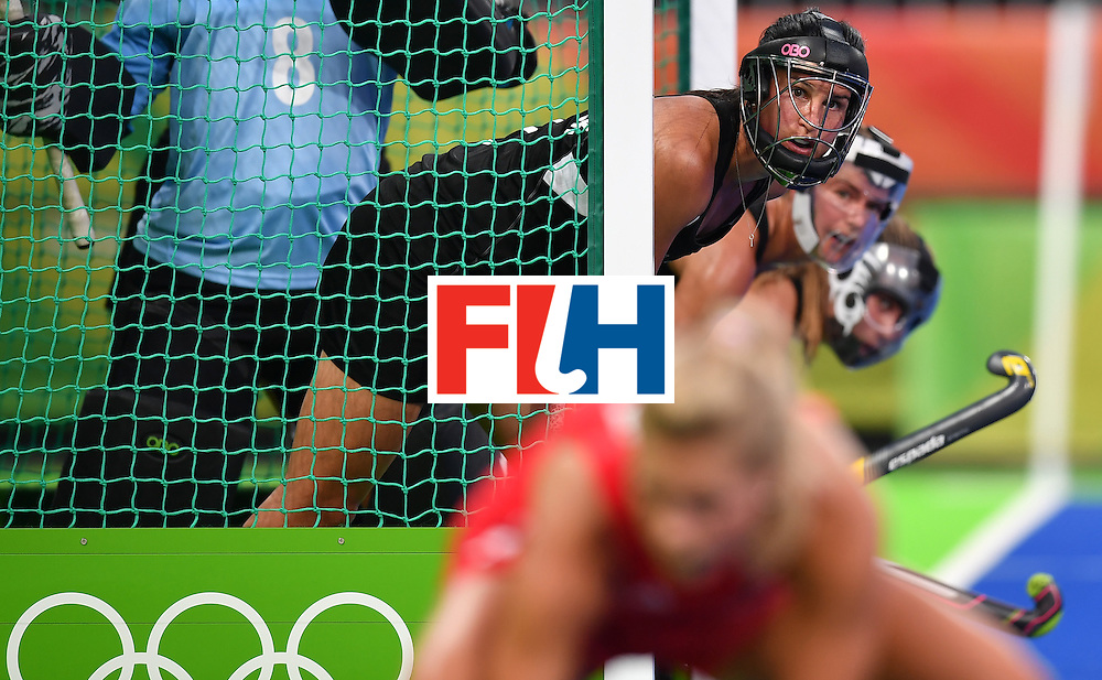 New Zealand's Kayla Whitelock (3rd R) defends her goal with teammates during the women's semifinal field hockey New Zealand vs Britain match of the Rio 2016 Olympics Games at the Olympic Hockey Centre in Rio de Janeiro on August 17, 2016. / AFP / MANAN VATSYAYANA        (Photo credit should read MANAN VATSYAYANA/AFP/Getty Images)