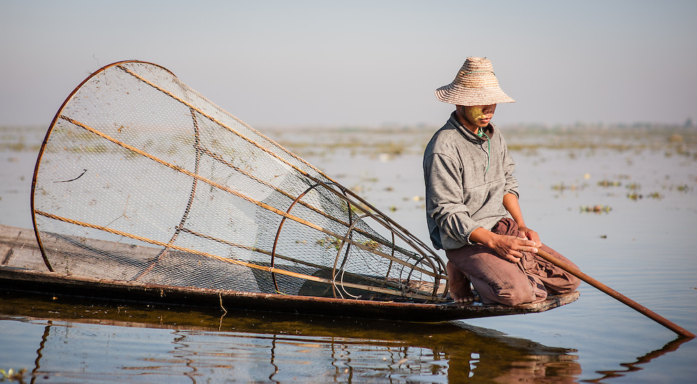 Fishing boy on his boat in Inle Lake (Myanmar)