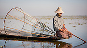 Fishing boy on his boat in Inle Lake (Myanmar)