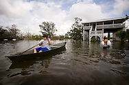 A Member of the Guy family uses a boat in front of his home in the floodwaters from Hurricane Gustav September 3, 2008 in Chauvin, Louisiana. Chauvin is located just north of Cocodrie, where Hurricane Gustav made landfall.