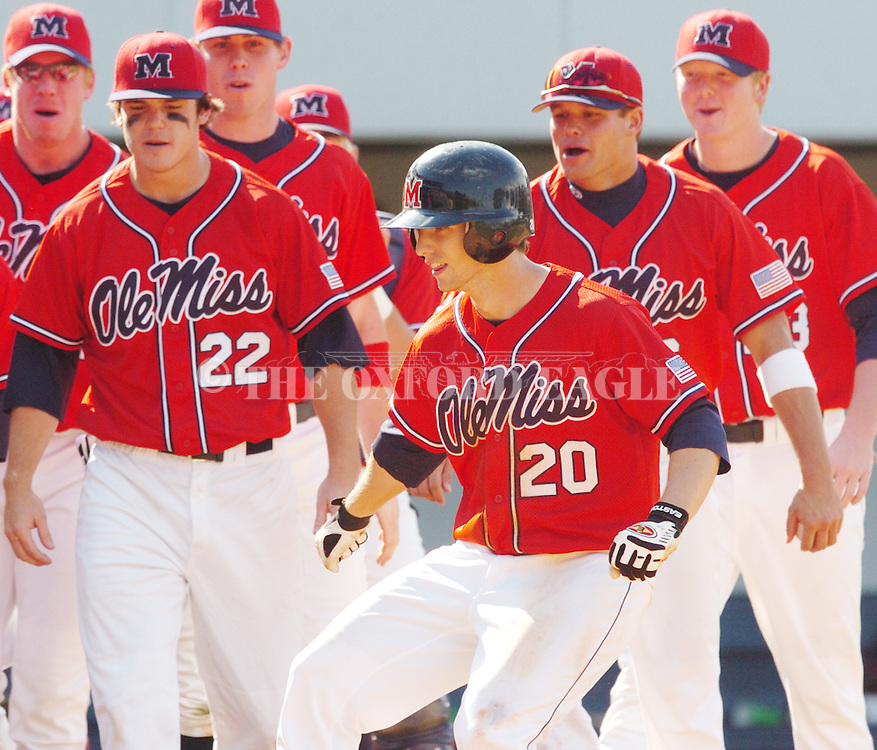 Mississippi's Alex Presley (20) is congratulated by teammates following his two-run home run against Arkansas in a college baseball game in Oxford, Miss. Saturday, May 13, 2006. (AP Photo/Oxford Eagle, Bruce Newman)
