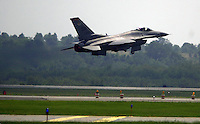 Chris Rolinson<br /> Air Force Captain Randy Eferson, stationed at Shaw Air Force Base in Sumpter, South Carolina, flies his F-16 Viper takes off from Pittsburgh International Airport, Sunday, duing the Wings Over Pittsburgh Airshow. The show was sponsored by the 911th Air Refueling Wing stationed at the airport.
