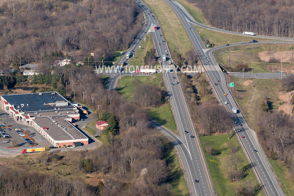 Maybrook, New York - An aerial view over Interstate 84 at Exit 5, where the highway travels over Route 208 on April 20, 2016. The view is looking east.