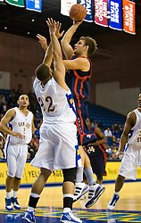 November 30, 2009; San Jose, CA, USA;  Saint Mary's Gaels center Ben Allen (21) shoots over San Jose State Spartans forward C.J. Webster (22) during the second half at the Event Center Arena.  Saint Mary's defeated San Jose State 78-71.