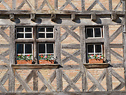 Many buildings in the village of Lauzerte dated back to Medieval times. These windows are an example of the type of architecture still found throughout many areas of South-West France.