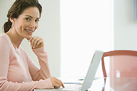 Mid-adult office worker with laptop