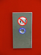 Vienna, Austria. The new WU Campus (University of Economics).<br /> D1 (Departments 1) and TC (Teaching Center) by BUSarchitektur, Vienna.<br /> Elevator detail: fire warning pictogram.