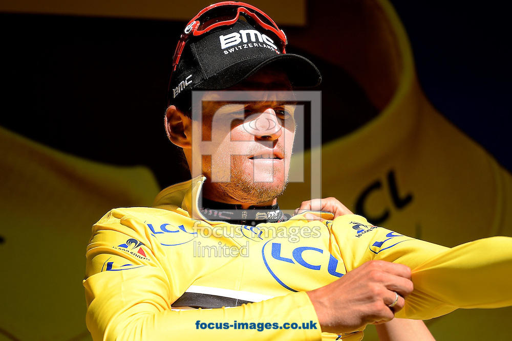 Greg Van Avermaet of Team BMC puts on the Yellow Jersey after winning stage 5 of the Tour de France at La Lioran, France.<br /> Picture by Focus Images/Focus Images Ltd 07814 482222<br /> 06/07/2016