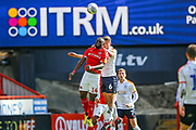 Luton Town defender Matthew Person (6) clash in the air with Charlton Athletic forward Igor Vetokele (14) during the EFL Sky Bet League 1 match between Charlton Athletic and Luton Town at The Valley, London, England on 13 April 2019.