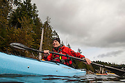 Dave Pinel kayaks on Comox Lake, BC. on Feb. 23, 2013.