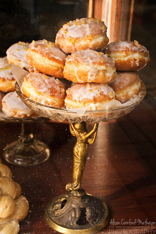 Iced doughnuts await buyers in a traditional Polish bakery and cafe in Krakow, Poland.