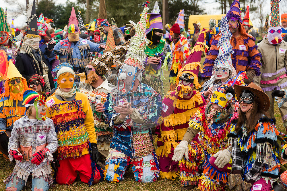 Revelers in traditional costume line up ready to catch a live chicken during the Faquetigue Courir de Mardi Gras chicken run on Fat Tuesday February 17, 2015 in Eunice, Louisiana. The traditional Cajun Mardi Gras involves costumed revelers competing to catch a live chicken as they move from house to house throughout the rural community.
