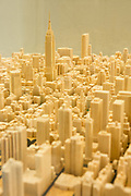 A wooden model of midtown Manhattan in 1:3200 scale, carved by Arizona modelmakre Michael G Chesko., who got his infomrataion from satellite imagery. books and maps.