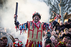© Licensed to London News Pictures. 06/01/2018. Haxey UK. Picture shows the Fool making his speech to mark the start of The Haxey Hood game that is taking place today in the village of Haxey in Lincolnshire. The Haxey Hood is a traditional event that takes place every January & is played by teams from four pubs, the Carpenters Arms, the Duke William Hotel, The Loco & The kings Arms. The game is like a large rugby scrum called the 'sway' which pushes a leather tube called the 'hood' to one of the four pubs, the game is won when a team gets the hood to the front step of the pub & it is touched by the landlord.  Photo credit: Andrew McCaren/LNP
