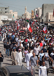 © under license to London News Pictures.  18/02/2011. People walk to the cemetary to bury Ali Al Almoumem, the third person to be buried today in Sitra after he was killed on Wednesday at the Pearl Roundabout. Photo credit should read Michael Graae/London News Pictures